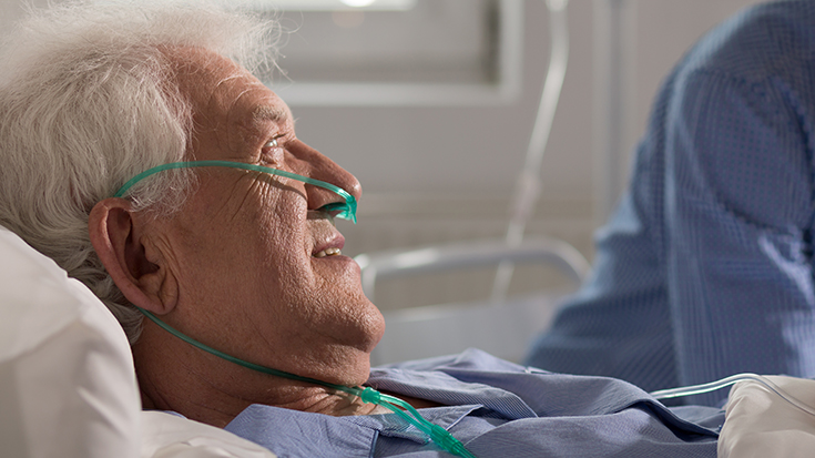 image of man in hospital bed